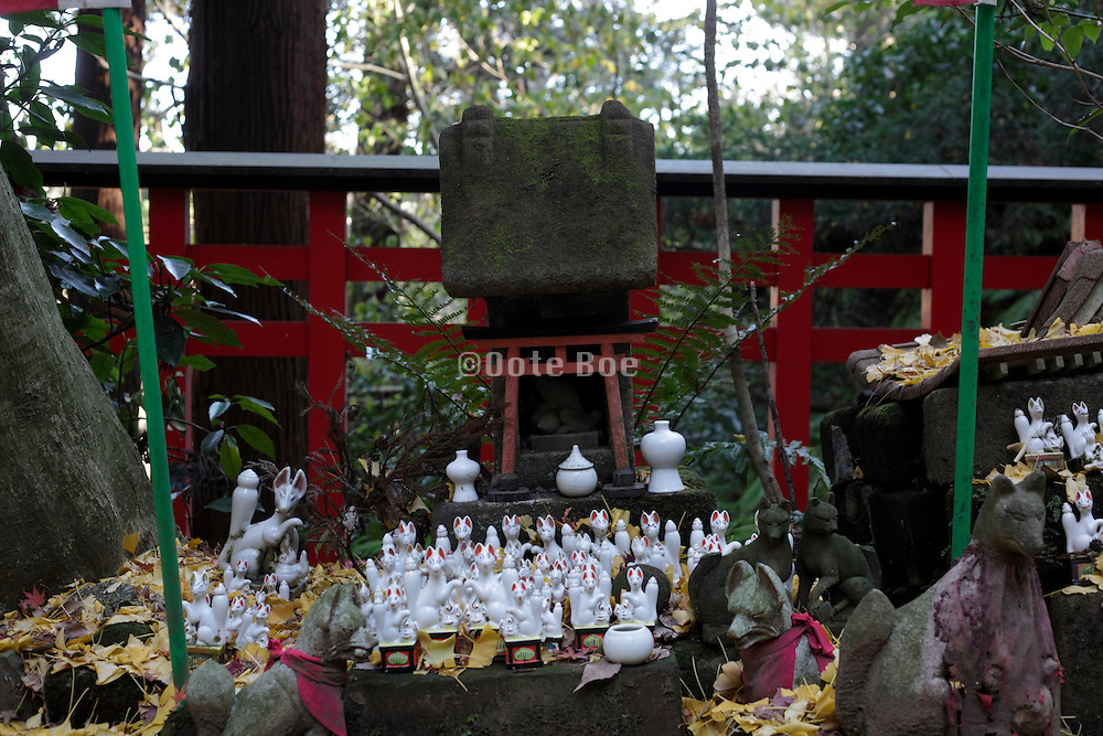a small ritual altar with fox messenger and gate Kamakura Japan