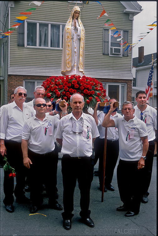 GLOUCESTER, MA- JUNE 29, 2003:  The statue bearers of the Virgin Mary during the annual celebration paying homage to St. Peter, the patron saint of fishermen in Gloucester, MA. The festa takes place on the weekend closest to the Feast Day of St. Peter, June 29. .(Photo by Robert Falcetti) . .