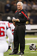 NEW ORLEANS, LA - DECEMBER 26:   Head Coach Mike Smith of the Atlanta Falcons watches his team warm up before a game against the New Orleans Saints at Mercedes-Benz Superdome on December 26, 2011 in New Orleans, Louisiana.  The Saints defeated the Falcons 45-16.  (Photo by Wesley Hitt/Getty Images) *** Local Caption *** Mike Smith