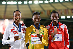 (L-R) Lashinda Demus of United States receives the silver medal, Melaine Walker of Jamaica the gold medal and Josanne Lucas of Trinidad and Tobago the bronze medal during the medal ceremony for the women's 400 Metres Hurdles Final during day six of the 12th IAAF World Athletics Championships at the Olympic Stadium on August 20, 2009 in Berlin, Germany. (Photo by Vid Ponikvar / Sportida)