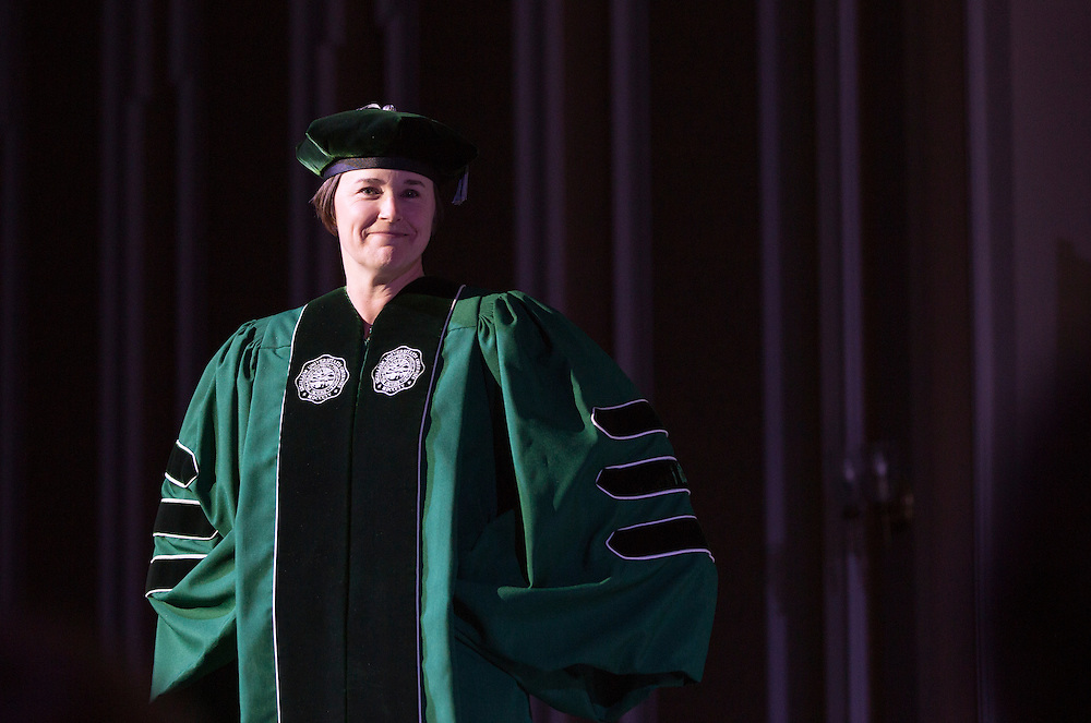 Jenny Hall-Jones, Dean of Students, stops on stage for the formal wear portion of the Faculty Pageant on February 22, 2016.