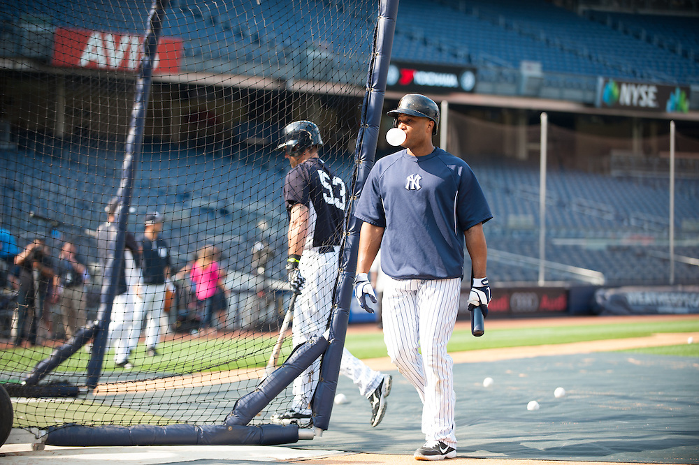 NEW YORK - MAY 30:  Robinson Cano #24 of the New York Yankees blowing a bubble at batting practice before the game against the New York Mets at Yankee Stadium on May 30, 2013 in the Bronx borough of Manhattan. (Photo by Rob Tringali) *** Local Caption ***  Robinson Cano