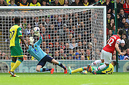 John Ruddy of Norwich saves a shot by Olivier Giroud of Arsenal during the Barclays Premier League match at Carrow Road, Norwich<br /> Picture by Paul Chesterton/Focus Images Ltd +44 7904 640267<br /> 11/05/2014
