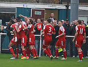 Whitehawk striker Danny Mills is mobbed after opening the scoring during the The FA Cup match between Whitehawk FC and Lincoln City at the Enclosed Ground, Whitehawk, United Kingdom on 8 November 2015. Photo by Bennett Dean.