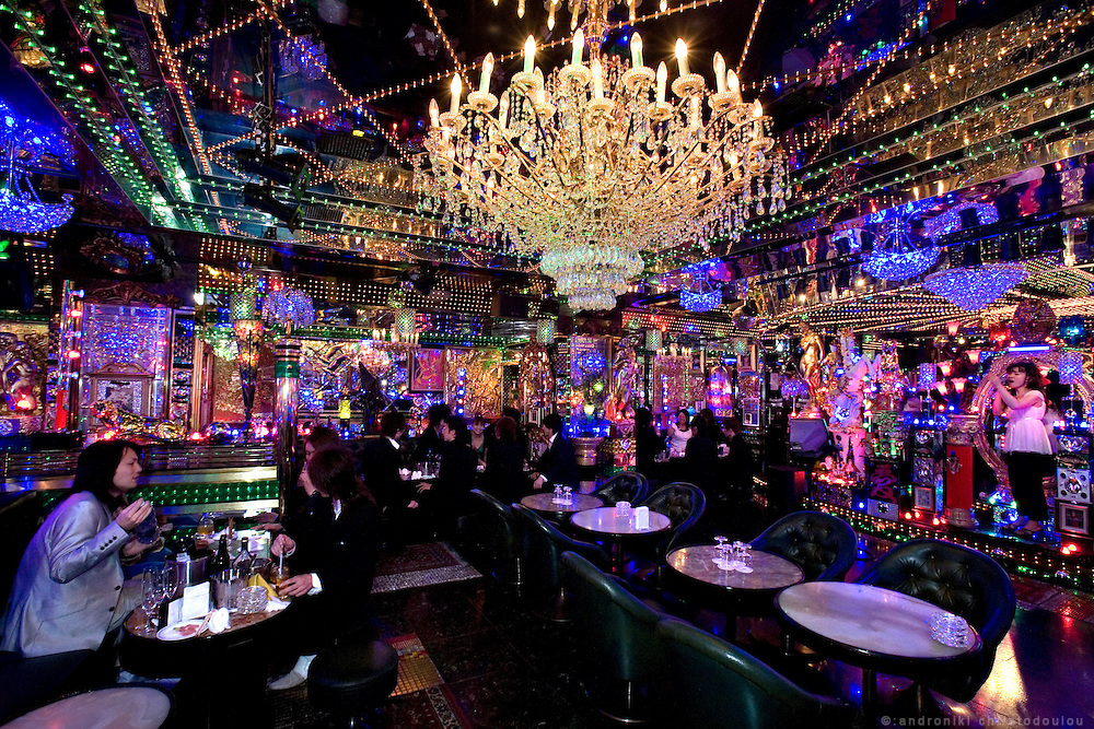 """The interior of club """"Ai"""" is filled with mirrors and decoration, creating a female friendly dream-like environment. Club """"Ai"""" (love in Japanese) is one of the oldest host clubs in Kabukicho entertainment area near Shinjuku. It started functioning 37 years ago, with hosts ready to take care of the needs of their female customers. The customers have to pay from 5000 friendly price for beginners, to millions of yen, depending on how good the host is in pleasing the customer and encouraging her to buy drinks. On top of these a good host can receive expensive gifts from his regular customers.  Tokyo - JAPAN"""