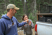 Brian Lynn of the Sportsmen's Alliance offers a sandwich to Angie Denny during an Idaho bear hunt.