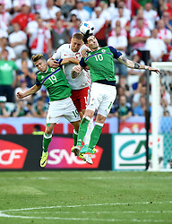 \Kamil Glik of Poland battles for the high ball with Kyle Lafferty and Jamie Ward of Northern Ireland  - Mandatory by-line: Joe Meredith/JMP - 12/06/2016 - FOOTBALL - Stade de Nice - Nice, France - Poland v Northern Ireland - UEFA European Championship Group C