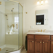 CREAM RIDGE, NJ - OCTOBER 29, 2016: The master bathroom on the second floor has a jetted tub, glass-enclosed stall shower and a view of the property. 92 Holmes Mill Rd, Cream Ridge, NJ. Credit: Albert Yee for the New York Times