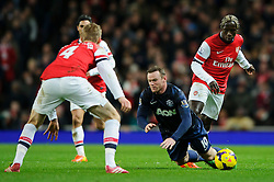 Man Utd Forward Wayne Rooney (ENG) is brought down by Arsenal Defender Bacary Sagna (FRA) - Photo mandatory by-line: Rogan Thomson/JMP - 07966 386802 - 12/02/14 - SPORT - FOOTBALL - Emirates Stadium, London - Arsenal v Manchester United - Barclays Premier League.