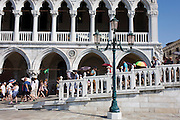 Tourist crowds outside the Doge's Palace in Piazza San Marco, Venice, Italy
