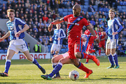 Rochdale forward Calvin Andrew is challenged in the box during the EFL Sky Bet League 1 match between Chesterfield and Rochdale at the Proact stadium, Chesterfield, England on 25 March 2017. Photo by Aaron  Lupton.