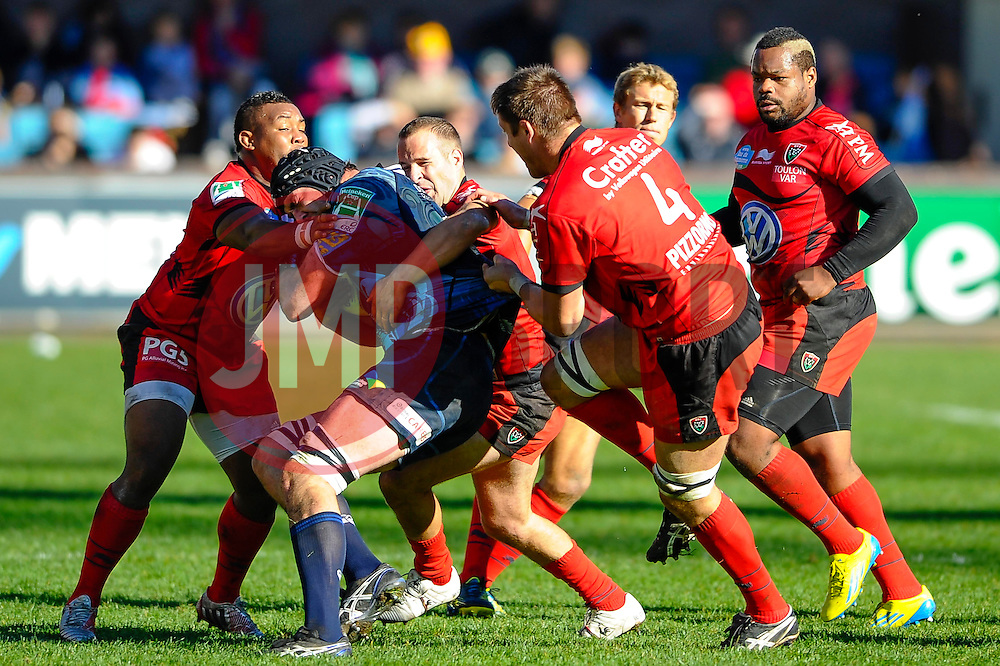 Cardiff Lock (#5) Lou Reed is tackled by Toulon Flanker (#7) Steffon Armitage and Lock (#4) Bakkies Botha during the second half of the match - Photo mandatory by-line: Rogan Thomson/JMP - Tel: Mobile: 07966 386802 21/10/2012 - SPORT - RUGBY - Cardiff Arms Park - Cardiff. Cardiff Blues v Toulon (RC Toulonnais) - Heineken Cup Round 2