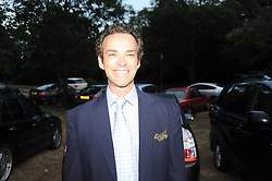 HENRY DENT-BROCKLEHURST leaving a summer party hosted by Lady Annabel Goldsmith at her home Ormeley Lodge, Ham Gate, Richmond on 13th July 2010.