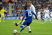 Swansea City midfielder Gylfi Sigurdsson attempts to block Leicester City forward Jeff Schlupp's cross during the Barclays Premier League match between Leicester City and Swansea City at the King Power Stadium, Leicester, England on 24 April 2016. Photo by Alan Franklin.