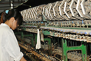 China, Shanghai Silk factory visitor Center spinning the silk fibre