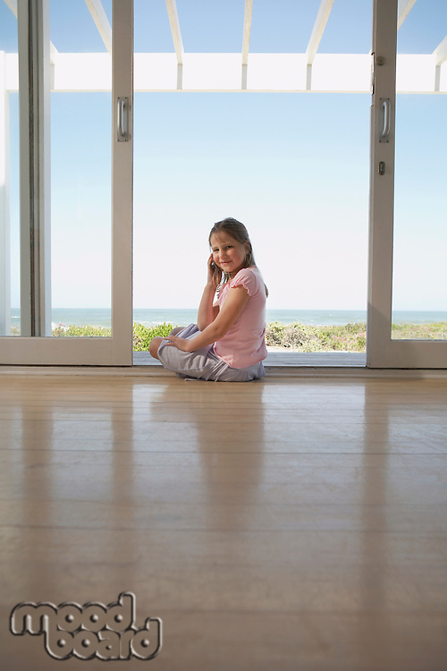 Girl Sitting By Glass Doors