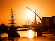6/10/10 Sunrise over the Liffey with the new Samuel Beckett bridge and the Poolbeg towers Pic:Marc O'Sullivan
