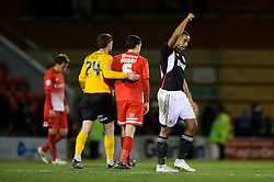 Bristol City Forward Tyrone Barnett (ENG) celebrates after his side win 3-1 and Leyton Orient Goalkeeper Shwan Jalal (ENG) and Defender Mathieu Baudry (FRA) console each other - Photo mandatory by-line: Rogan Thomson/JMP - 07966 386802 - 11/02/2014 - SPORT - FOOTBALL - The Matchroom Stadium, London - Leyton Orient v Bristol City - Sky Bet Football League 1.