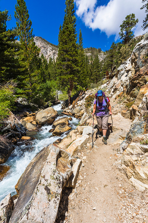 Backpacker on the North Fork of Big Pine Creek, John Muir Wilderness, California USA