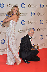 PAUL O'GRADY and AMANDA HOLDEN with a Battersea dog at Battersea Dogs & Cats Home's Collars & Coats Gala Ball held at Battersea Evolution, Battersea Park, London on30th October 2014.