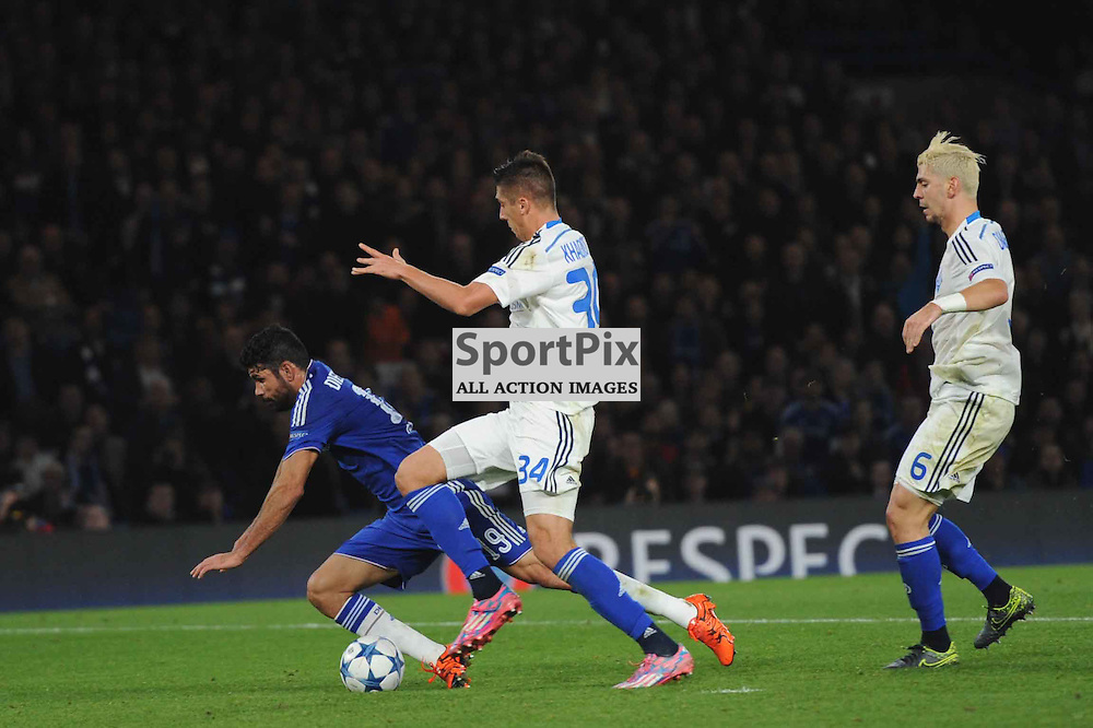 Chelseas Diego Costa goes down under pressure from Dynamo Kievs Aleksandar Dragovic (far right) and Yevhen Khacheridi in action during the Chelsea v Dynamo Kiev champions league match in the group stage on the 4th November 2015