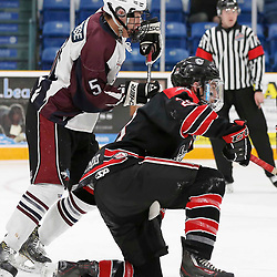 "TRENTON, ON  - MAY 2,  2017: Canadian Junior Hockey League, Central Canadian Jr. ""A"" Championship. The Dudley Hewitt Cup. Game 1 between Dryden GM Ice Dogs and the Georgetown Raiders. Josh Dickinson #28 of the Georgetown Raiders and  Matthew Pitchenese #5 of the Dryden GM Ice Dogs  battle in front of the net  <br /> (Photo by Amy Deroche / OJHL Images)"
