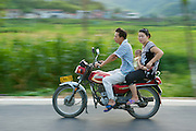 A family riding on a motorcycle in China.