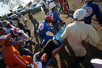 A man is carried off on a stretcher after being injured in the ring during the annual Corralejas in Sincelejo, Colombia on Friday, January 18, 2008. The corraleja, a bullfighting ritual in northern Colombia pitting hundreds of amateur matadors, many in advanced stages of inebriation, against a 900-pound bull. Regarded in other parts of Colombia as a bizarre spectacle, the corralejas are passionately defended by people of the northern savannas, an impoverished region. (Photo/Scott Dalton).