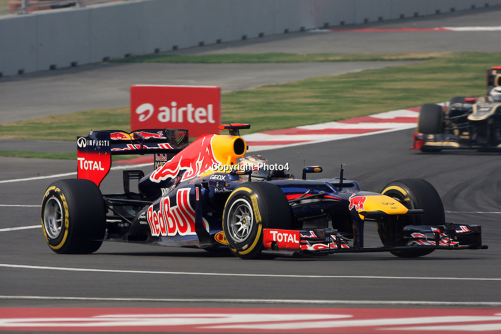 &copy; Photo4 / LaPresse<br /> 27/10/2012 Noida, India<br /> Sport <br /> Indian Grand Prix, Noida 25-28 October 2012<br /> In the pic: Sebastian Vettel (GER), Red Bull Racing, RB8 leads Kimi Raikkonen (FIN), Lotus F1 Team E20
