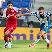 BARCELONA, SPAIN - August 18:  Jesus Navas #16 of Sevilla defended by Matias Vargas #22 of Espanyol during the Espanyol V  Sevilla FC, La Liga regular season match at RCDE Stadium on August 18th 2019 in Barcelona, Spain. (Photo by Tim Clayton/Corbis via Getty Images)