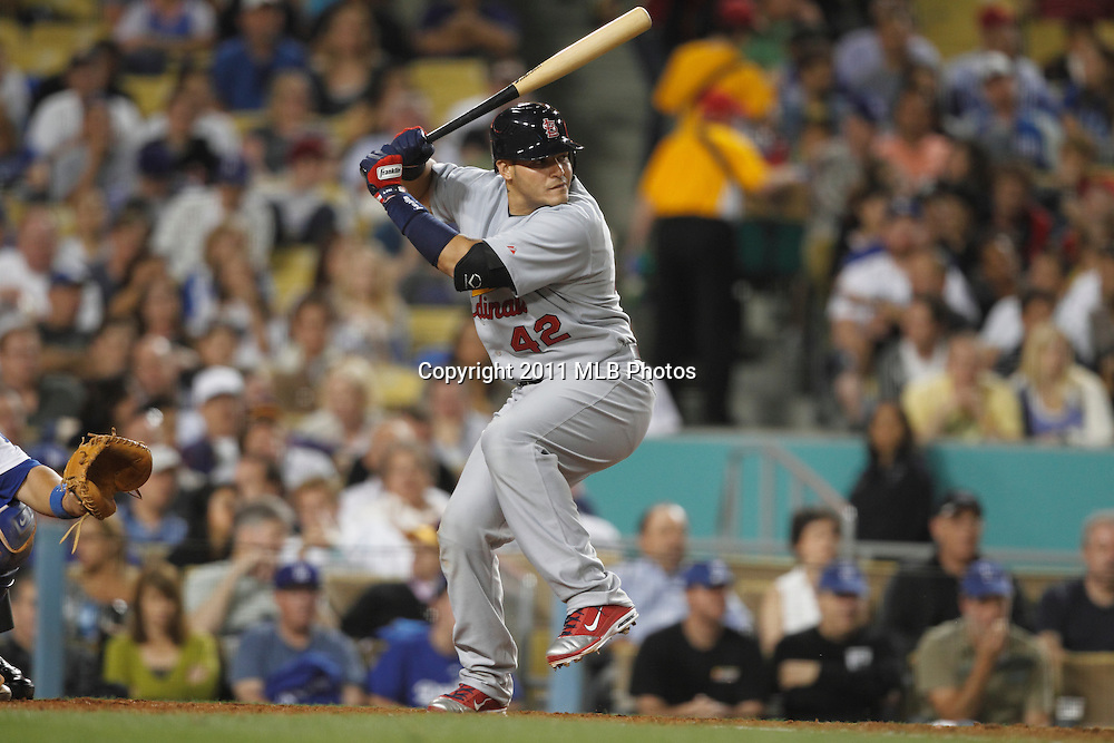 LOS ANGELES, CA - APRIL 15:  Yadier Molina #4 of the St. Louis Cardinals takes a swing at a pitch during the game between the St. Louis Cardinals and the Los Angeles Dodgers on Friday April 15, 2011 at Dodger Stadium in Los Angeles, California. (Photo by Paul Spinelli/MLB Photos via Getty Images) *** Local Caption *** Yadier Molina