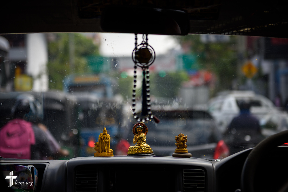 Buddhist and Hindu figurines on the dashboard of a van in Colombo, Sri Lanka on Friday, Jan. 19, 2018. Nearly 70% of the country follows Buddhism in the country. LCMS Communications/ Erik M. Lunsford