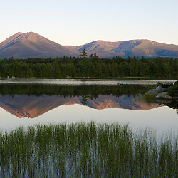 Mount Katahdin as seen in the early morning from Katahdin Lake in Maine's Baxter State Park.