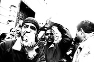 Palestinians shouting slogans through megaphone during the protest outside Israeli Consulate, San Francisco, 2002