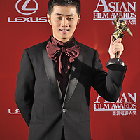 HONG KONG - MARCH 23:  Chinese actor Yu Shaoqun poses backstage with the Best Newcomer award for his role in 'Forever Enthralled' during the Asian Film Awards 2009 at the Hong Kong Convention and Exhibition Centre on March 23, 2009 in Hong Kong.  Photo by Victor Fraile / studioEAST