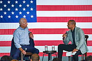 South State Senator Marlon Kimpson, right, asks former Vice President Joe Biden a questions during a town hall meeting as at the International Longshoreman's Association Hall July 7, 2019 in Charleston, South Carolina.