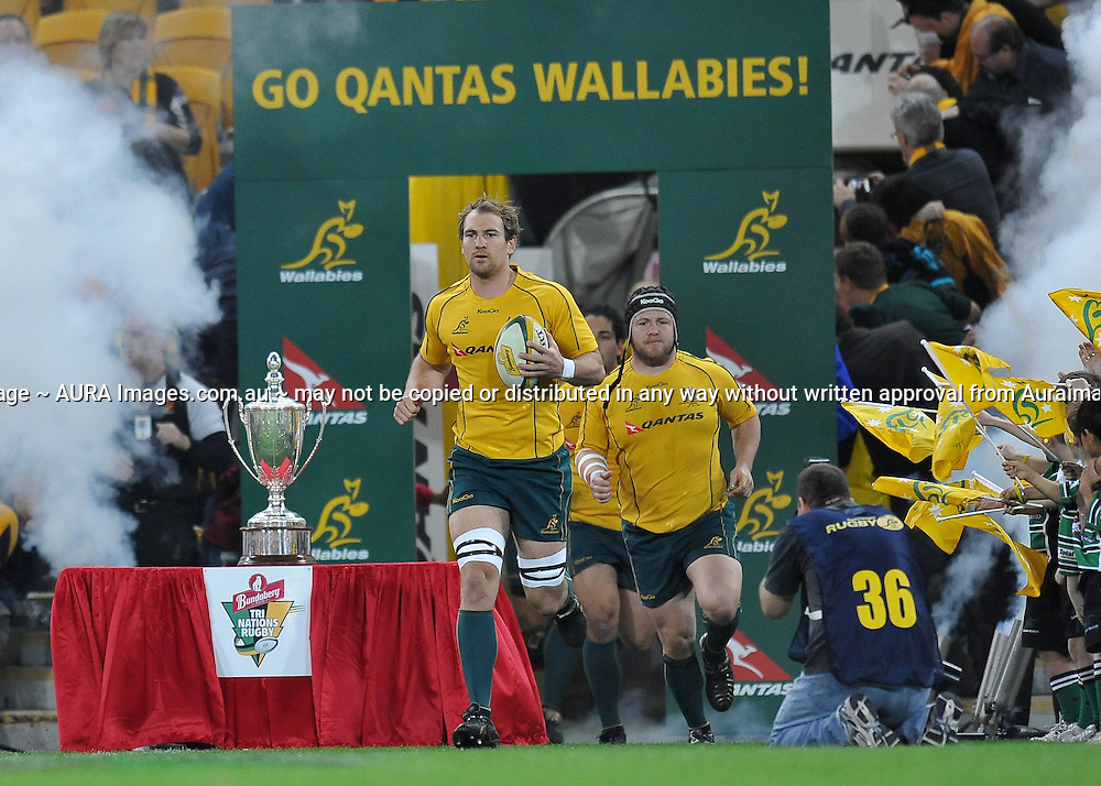 Rocky Elsom leads the Wallabies onto Suncorp Stadium past the Tri-Nations Cup during action from the Tri-Nations Rugby Test Match played between Australia and South Africa at Suncorp Stadium (Brisbane, Australia) on Saturday 24th July 2010<br /> <br /> Conditions of Use : This image is intended for Editorial use only (news or commentary, print or electronic) - Required Images Credit &quot;Steven Hight - Auraimages/Photosport