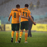 Luke Wilkshire (left) and Richard Garcia leave the field at the end of the match during the 2010 Fifa World Cup Asian Qualifying match between Australia and Uzbekistan at Stadium Australia in Sydney, Australia on April 01, 2009. Australia won the match 2-0.  Photo Tim Clayton