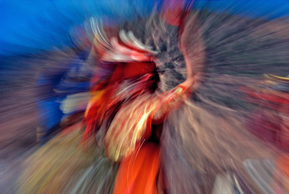 A long exposure of a swirling festival dancer creates a colorful impression of this famous spectacle in Thimphu, Bhutan.