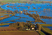 Nederland, Gelderland,  Gemeente Voorst, 20-01-2011; Gemaal Middelbeek (voorgrond) en Slot Nijenbeek (ook: Kasteel Nijenbeek of Het Hooge Huis), bij hoogwater van de IJssel en ondergelopen uiterwaarden. ..Castle Nijenbeek in the middle of the high waters and pumping-station Middelbeek (bottom)  on the bank of the river IJssel. luchtfoto (toeslag), aerial photo (additional fee required).copyright foto/photo Siebe Swart