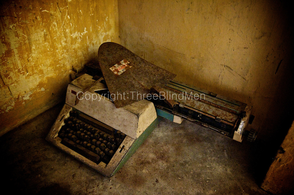 Discarded typewriter and garden shovel. Jaffna homes. 2011