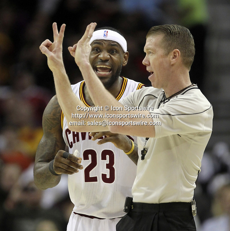 Feb. 11, 2015 - Cleveland, Ohio, U.S. - The Cleveland Cavaliers' LEBRON JAMES questions a first-quarter foul call by official ED MALLOY during action against the Miami Heat at Quicken Loans Arena