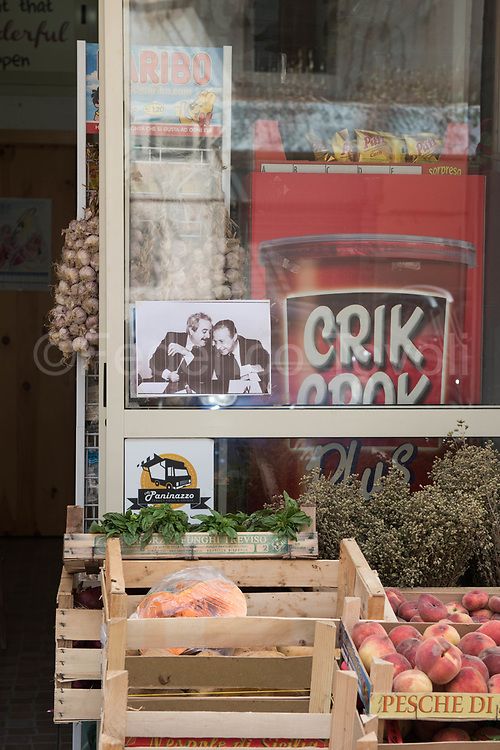 """The symbolic  image of judges  Falcone and Borsellino, killed by mafia in 1992, is also displayed on the display windows of anonymous stores, a sign of refusal of mafia logic that once called for """"protection""""."""