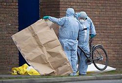 © Licensed to London News Pictures. 03/04/2018. London, UK. Police put a bicycle in an evidence bag outside Walthamstow Leisure Centre after a youngster was shot and another was stabbed. A few miles away in Tottenham police are investigating after a 17 year old girl was shot and killed late last night. Photo credit: Peter Macdiarmid/LNP