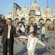 A young boy feeds the pigeon's in Piazza San Marco, Venice, Italy. 1st May 2011. Photo Tim Clayton