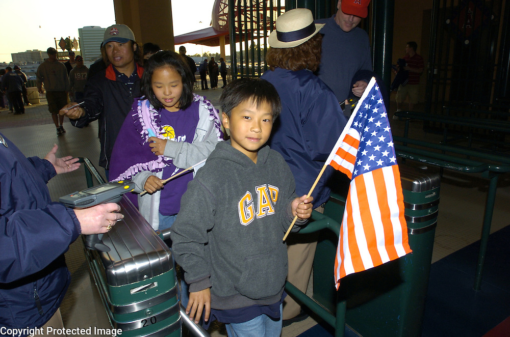 A young Team USA fan enters the stadium before the start of Round 2 action matching Team Korea and Team USA at Angel Stadium of Anaheim.