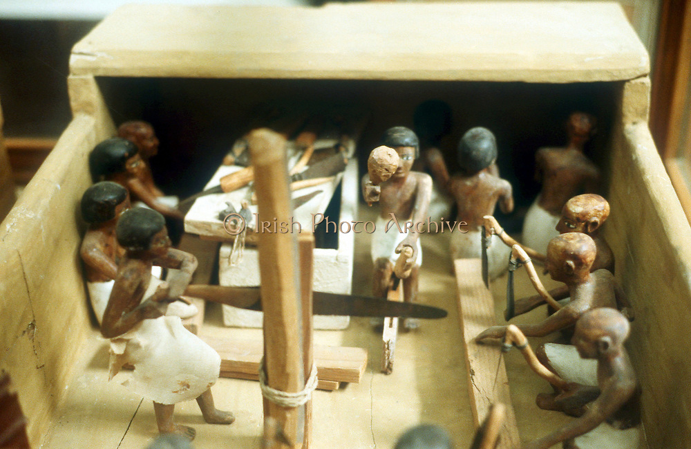 Carpenters in workshop model figures from Egyptian tomb.