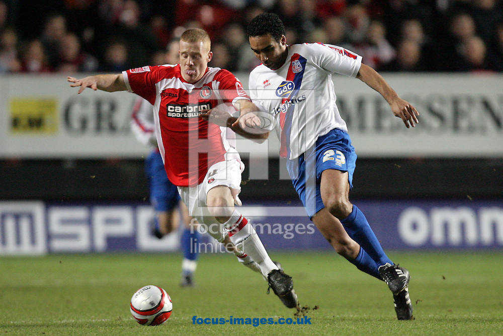 London - Tuesday December 27th, 2009: Nicky Bailey (L) of Charlton Athletic in action against Paul Ifill of Crystal Palace during the Coca Cola Championship match, London. (Pic by Mark Chapman/Focus Images)