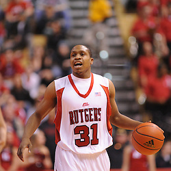 Jan 31, 2009; Piscataway, NJ, USA; Rutgers guard Mike Coburn (31) carries the ball into the offensive half court during the second half of Rutgers' 75-56 victory over DePaul in NCAA college basketball at the Louis Brown Athletic Center