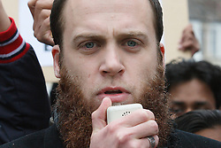 © Licensed to London News Pictures FILE PICTURE 15/06/2010. London, UK: British Muslim convert Richard Dart speaking at a Muslims Against Crusades demonstration. Richard Dart's wife, Ayan Hadi, 31, is due to appear at the Old Bailey tomorrow accused of witholding information from the police which  have helped in securing the apprehension of Richard Dart. Photo Credit LNP